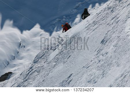 Chamonix-Mont-Blanc, France - May 20, 2016: Unknown People at Extreme Skiing and Mountaineering area Vallee Blanchet at Aiguille de Midi (3842m) in the Mont Blanc Massif.