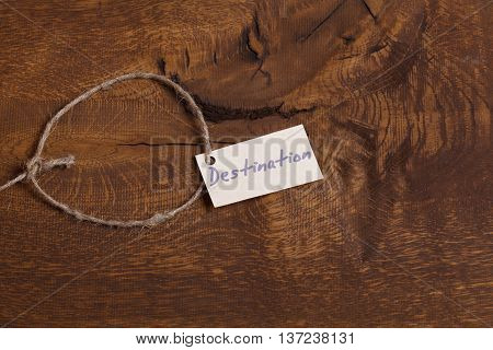 Sign Destination - travel concept. Sign lays on wooden plate