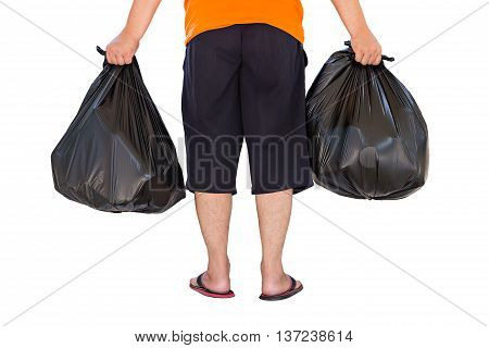 Low Section Of Young Man Carrying Garbage Bags Isolated On White Background