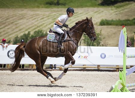 Turda, Cluj, Romania - June 19, 2016: An unidentified competitor jumps with his horse at the Salina Equines Horse Trophy , June 19, 2016 in Turda, Romania