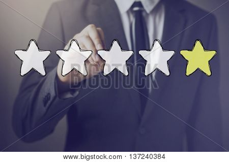 Businessman Drawing One Star In The Air