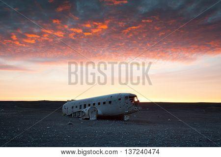 The abandoned DC-3 Airplane on Solheimasandur beach.  Airplane wreckage on black sand beach. Douglas Dakota DC3, US navy, South Iceland.
