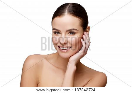 Beautiful Face of Young Woman with Clean Fresh Skin close up isolated on white. Beauty Portrait. Beautiful Spa Woman. Perfect Fresh Skin. Pure Beauty Model. Youth and Skin Care Concept poster