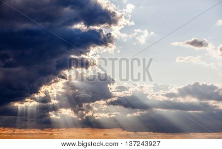 Sun Shining Through The Stormy Clouds