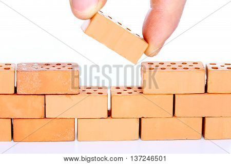 buildup a wall with the last brick