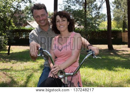 Midle Aged Couple On Country Bike Ride Happiness