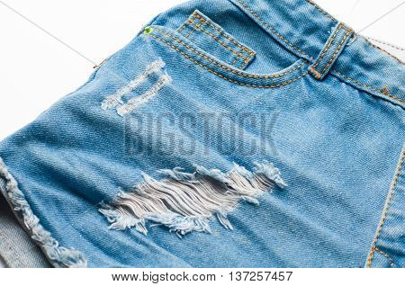 Women's Blue jeans shorts on white background.
