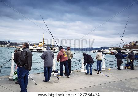 Istanbul Turkey - December 4 2013: Istanbul at the Bosphorus bonito bluefish mackerel sardines sea bass and other bottom fish hunt. Migration time increases in fishing catch fish.