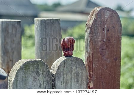 Netsuke eagle with monkey in talons on lumber fence