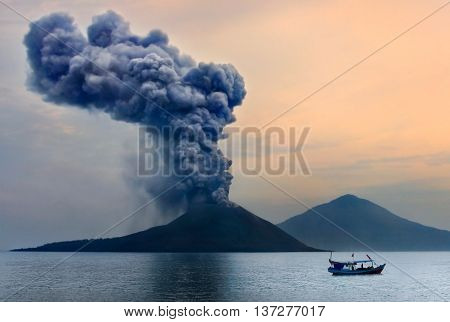 Volcano eruption. Anak Krakatau Indonesia. Boat on the background