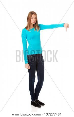 Dissatisfied female student showing thumbs down