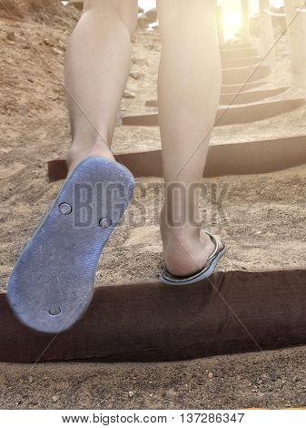 woman legs going upstairs suring summer sunset
