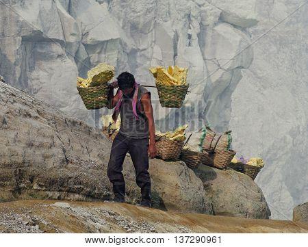 Worker Carries Sulfur Inside Crater  In Ijen Volcano, Indonesia