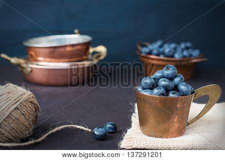 Blueberries Dark Picture. Fresh Fruits, Berries In An Old Copper Cup. Dark Styled Stock Photo, Black