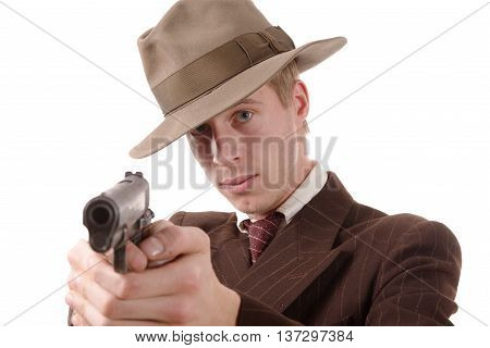 gangster in a suit vintage aim with a gun on white