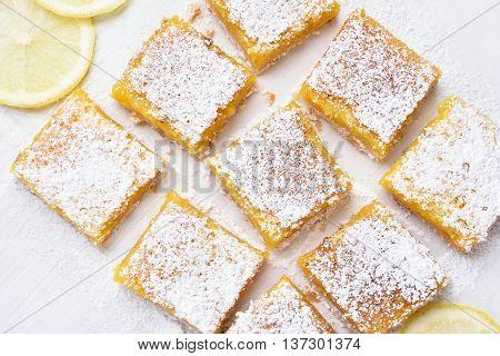 Dessert lemon bars over baking paper top view