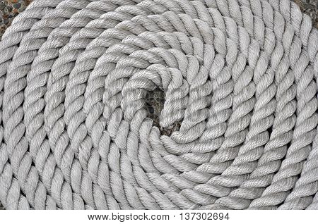 Twisting rope cords in a circle pattern