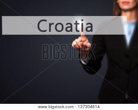 Croatia - Female Touching Virtual Button.