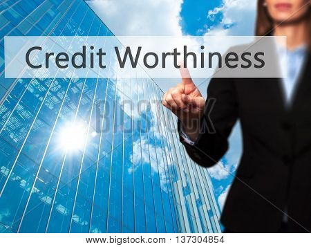 Credit Worthiness - Female Touching Virtual Button.