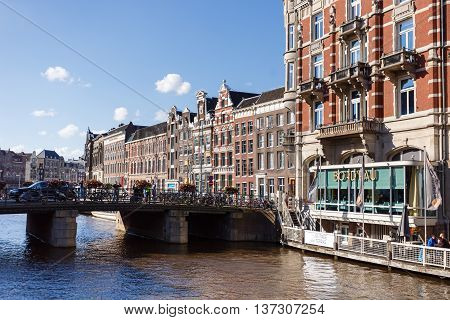 Amsterdam Netherlands - July 02 2016: View of the buildings on the Oude Turfmarkt street in Amsterdam city summer time