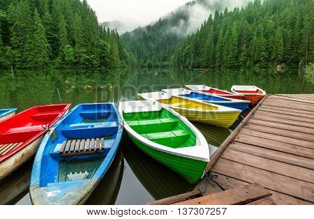Colorful boats moored on a mountain lake