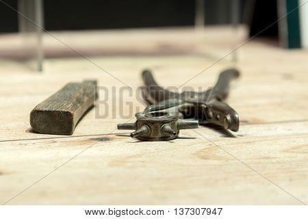 Cobblers shoemakers' tools on Wooden Worktop Bench