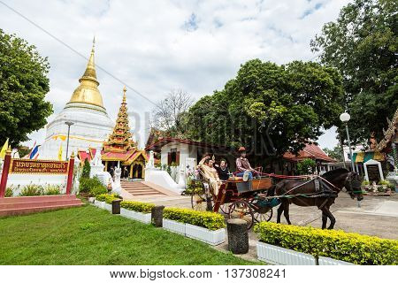 Lampang Province Thailand. 5 July 2016 : Traditional Horse Carriage at Wat Phra Kaew Don Tao is a Lanna-style Buddhist temple in Lampang in Lampang Province Thailand.