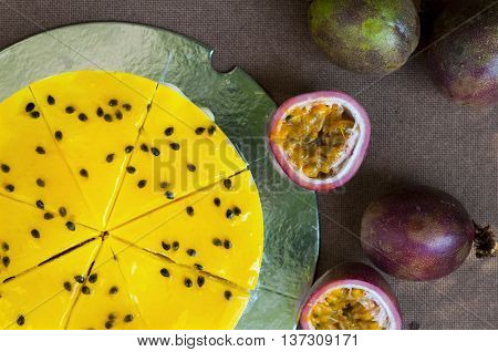 Fresh passion fruit cheesecake on the table