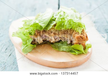 Sandwich With Cheese, Ham And Salad On A Blackboard Bitten Off