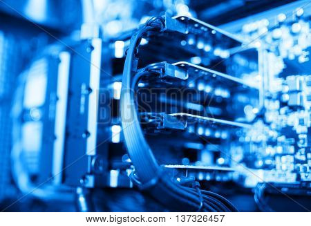 Horizontal blue gpu quad sli video card bokeh background