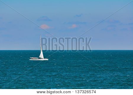 White Yacht Goes to the Port in the Black Sea