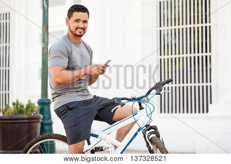 Attractive Cyclist Using A Smartphone