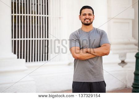 Attractive Young Man Working Out In The City