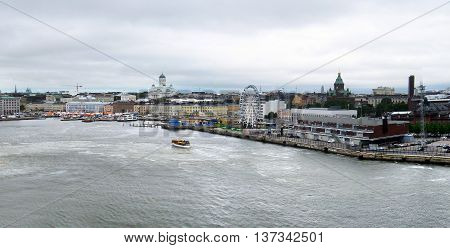 Aerial panorama image of Helsinki, Finland, featuring the Lutheran cathedral and the marketplace.