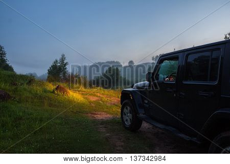 Leningrad region, Russia , July 1, 2016 , Jeep Wrangler on a forest road in the July white night, the Jeep Wrangler is a compact four wheel drive off road and sport utility vehicle