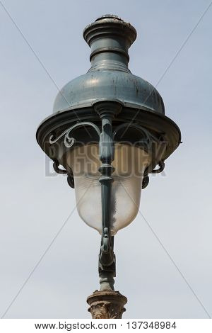 Parisian streetlamp with sky behind it, France