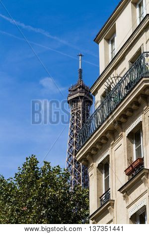 Old large frontage with Eiffel Tower behind. Paris France Europe.