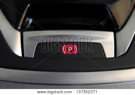 detail in a car with electric parking brake button
