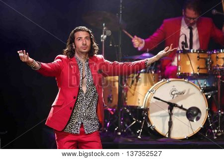 HUNTINGTON, NY-MAR 7: Singer Nasri (L) of the reggae fusion band Magic! performs in concert at The Paramount on March 7, 2015 in Huntington, New York.