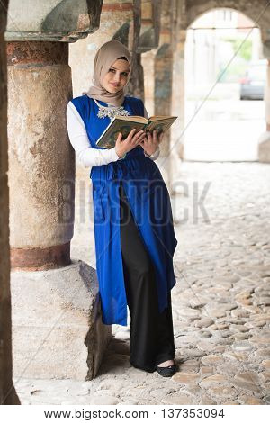 Young Muslim Woman Reading Holy Islamic Book Koran