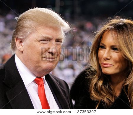 EAST RUTHERFORD, NJ-NOV 13: Donald Trump and wife Melania Trump before a football game at MetLife Stadium on November 13, 2011 in East Rutherford, New Jersey.