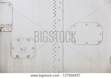 photographed close-up of metal siding military plane in gray, close-up, small depth of field