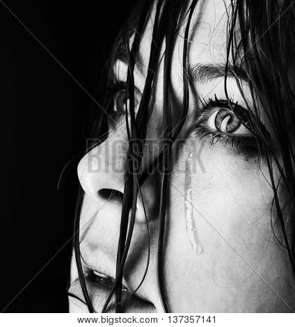 beauty girl cry on black background