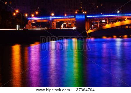 Bridge over the Moscow river at night with illumination and colorful reflection in the water, Art Effect light blur.