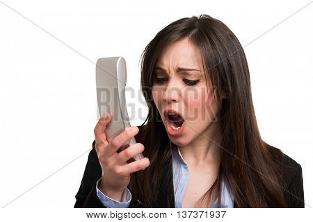 Angry woman yelling at the telephone