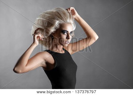 Updo Vogue Style. Woman with Futuristic Hairdo. Fashion. Hairstyle