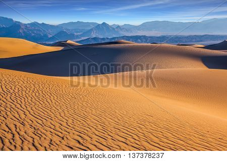 Mesquite Flat Sand Dunes in California. Small sandy ripples on orange barkhans
