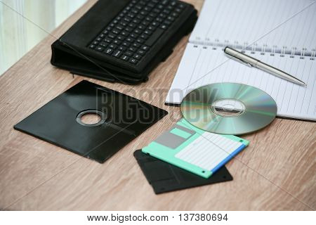 desk with note ,floppy disk A, floppy disk B and memory drive in home office, private office and modern desk in modern life, online market and planning for work, document and paper on desk.