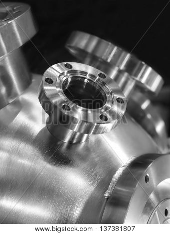 Flanged vacuum equipment. Shiny metal surface. Focus on a casing.