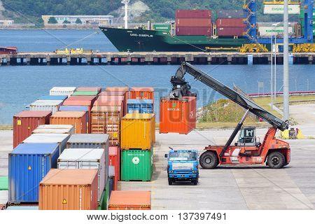 Kota Kinabalu Sabah Malaysia - Feb 15 2016:Container handling at Sabah Port Sapanggar Port pictured on Feb 15 2016.Sapanggar Port is a major container hub for Borneo.